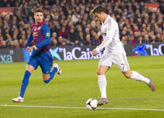 Pique-vs-Ronaldo-shutterstock